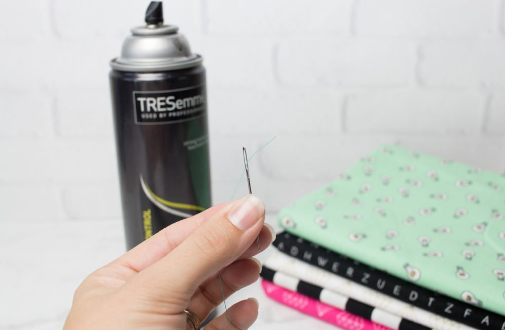 Easily thread a needle with the help of hairspray