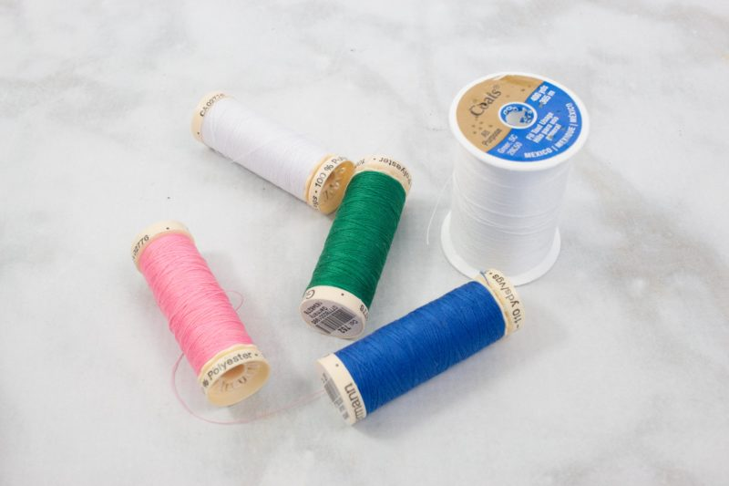 Buy a variety of colored thread when you want to learn to sew