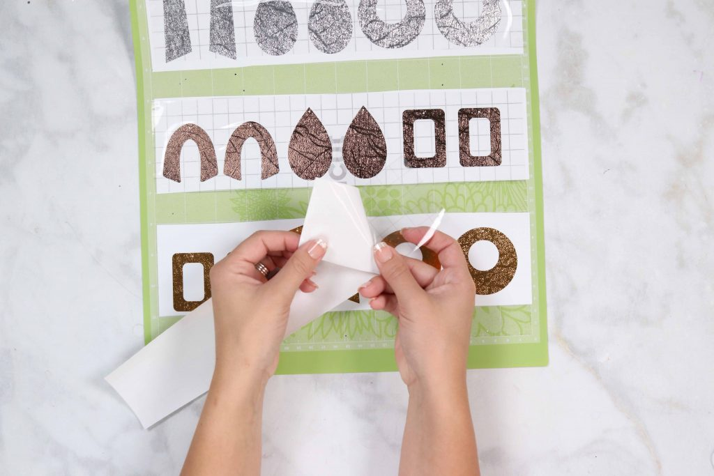 Cricut leather earrings tutorial featured by top US Cricut blogger, Sweet Red Poppy