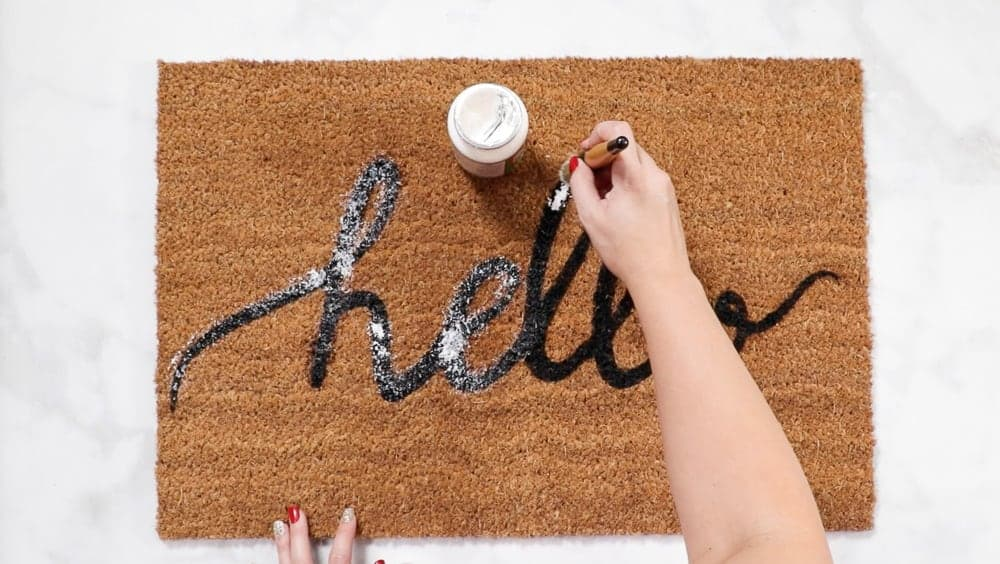 Apply Mod Podge layer to custom diy doormat for extra protection