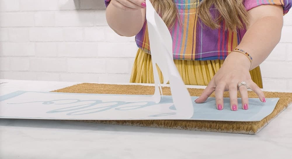 How to create a custom stencil from freezer paper for diy doormat.
