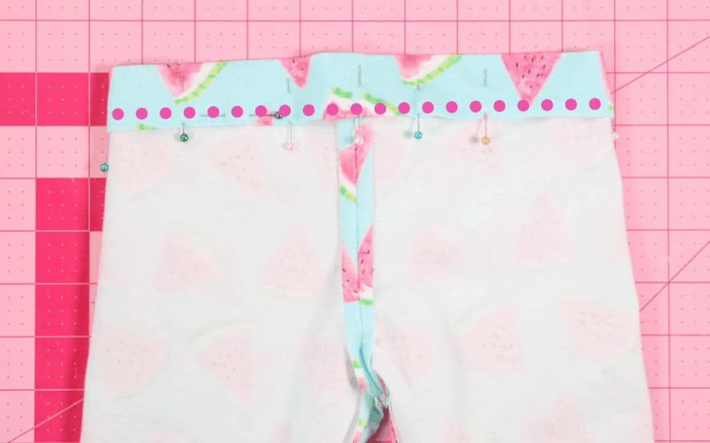Fold & Press the Waistband  Leggings Pattern by popular US sewing blog, Sweet Red Poppy: image of a kids leggings waistband folded and pinned.