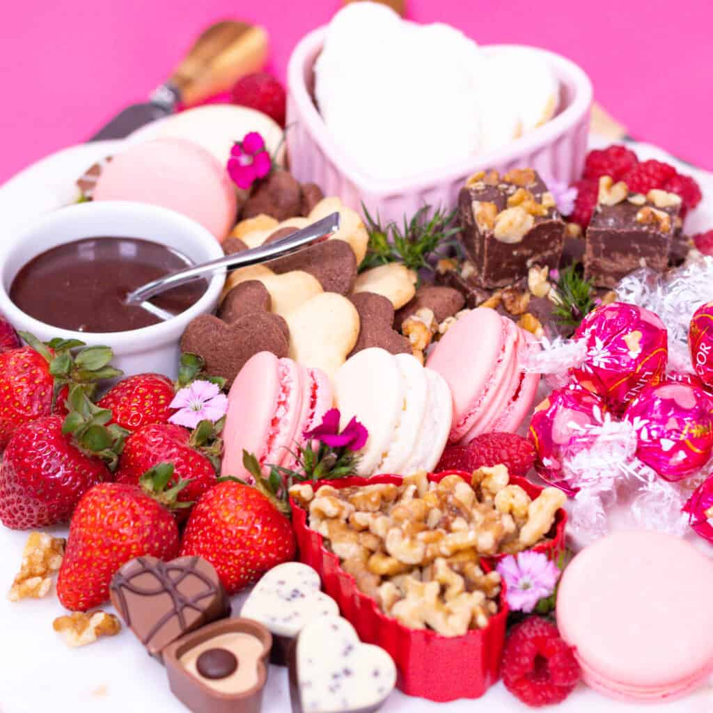 Dessert Charcuterie Board by popular Utah craft blog, Sweet Red Poppy: image of a dessert charcuterie board filled with fruit, cookies, chocolate sauce, chocolate candy, nuts, and macaroons.