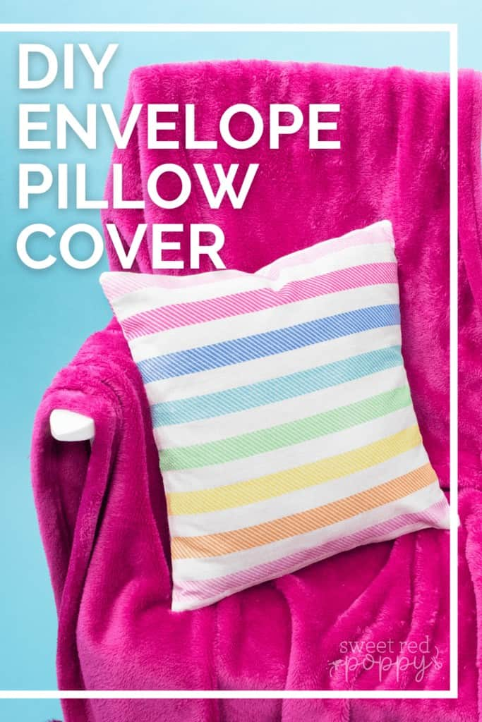 Making an Envelope Pillow Cover Is Easier Than Ever With This Simple Step-by-Step Tutorial and Video Guide! Learn How to Make an Envelope Pillow Cover in Less Than 15 Minutes!  How to Make an Envelope Pillow Cover With One Piece of Fabric by popular Utah sewing blog, Sweet Red Poppy: Pinterest image of a rainbow stripe print envelope pillow cover on a white bench with a pink throw blanket.