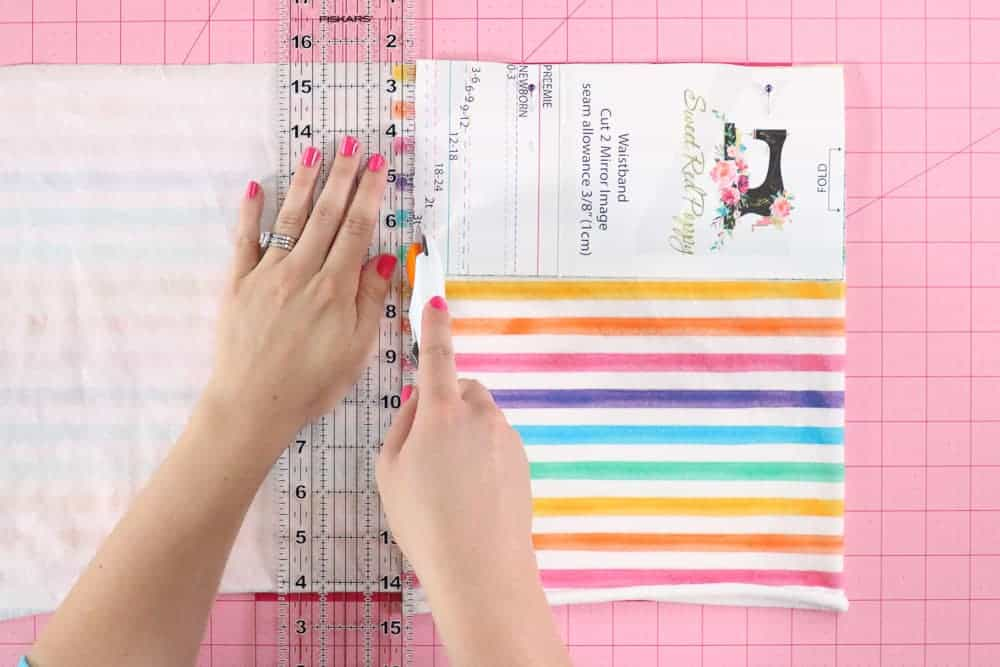 Cut out the Leggings Pattern Pieces |Leggings Pattern by popular US sewing blog, Sweet Red Poppy: image of a woman cutting out kids leggings.