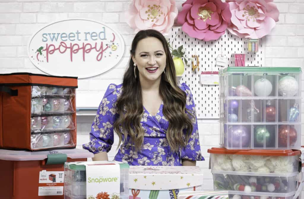Joann Christmas Storage by popular US craft blog, Sweet Red Poppy: image of a woman standing next to Joann storage and organization containers.
