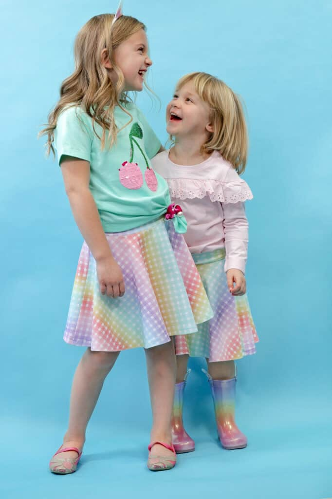 Circle Skirt by popular US sewing blog, Sweet Red Poppy: image of two young girls wearing circle skirts.