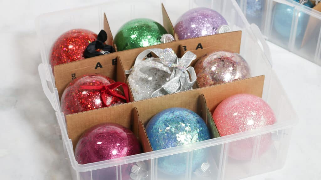 Joann Christmas Storage by popular US craft blog, Sweet Red Poppy: image of Christmas ornaments in a Snapware storage box.