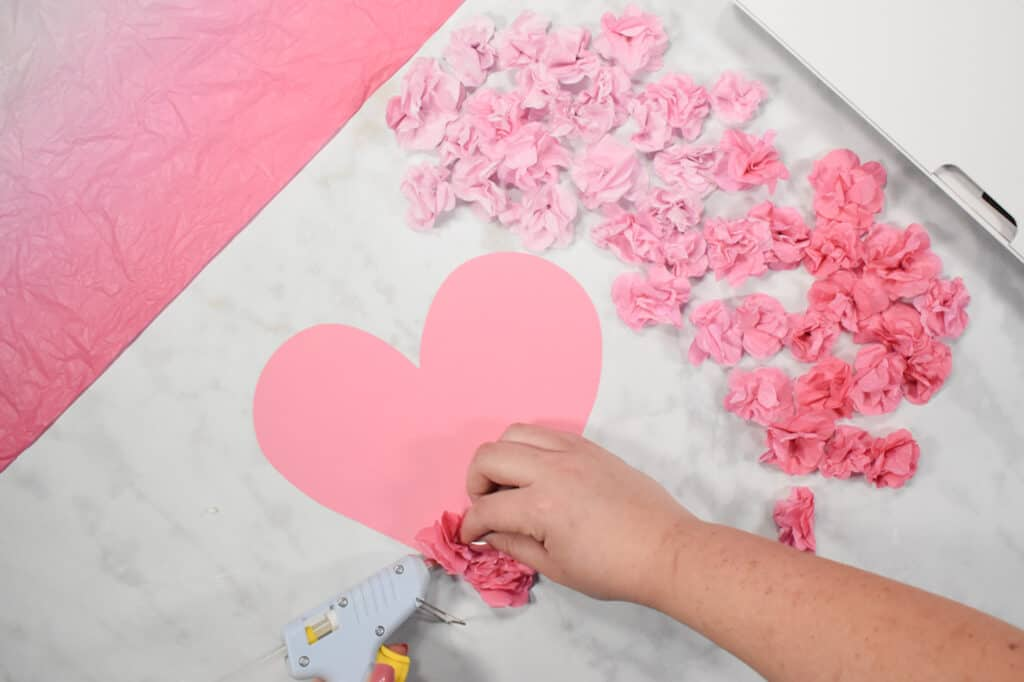 Cricut Shadow Box by popular US craft blog, Sweet Red Poppy: image of  a pink paper heart with paper flowers hot glued on to it.