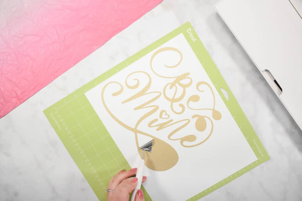 Cricut Shadow Box by popular US craft blog, Sweet Red Poppy: image of  a woman making a gold glitter vinyl design.