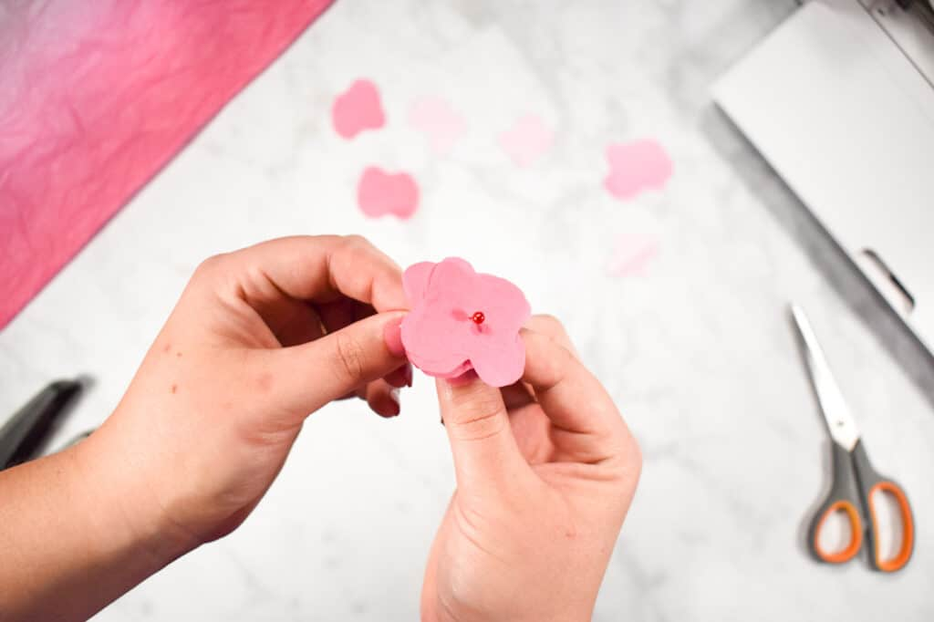Cricut Shadow Box by popular US craft blog, Sweet Red Poppy: image of  a woman making paper flowers.