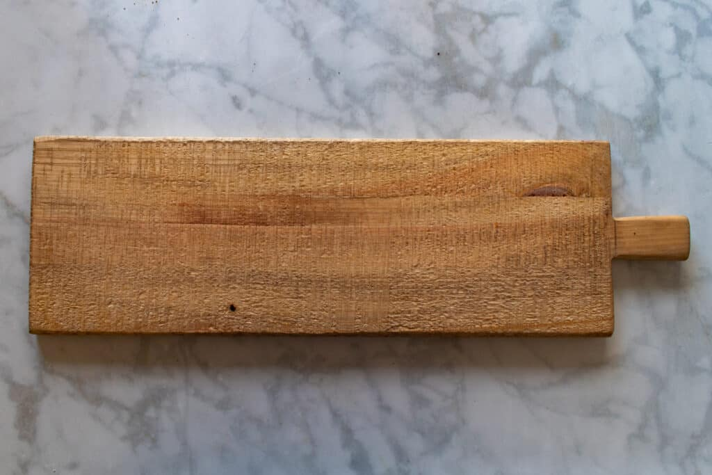 How to Assemble a Charcuterie Board by popular Utah craft blog, Sweet Red Poppy: image of a wooden board.