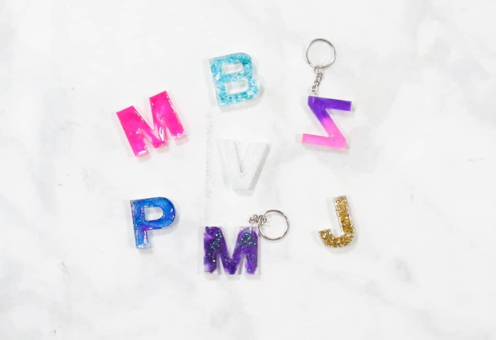 Resin Keychain by popular US craft blog, Sweet Red Poppy: image of letter resin keychains.