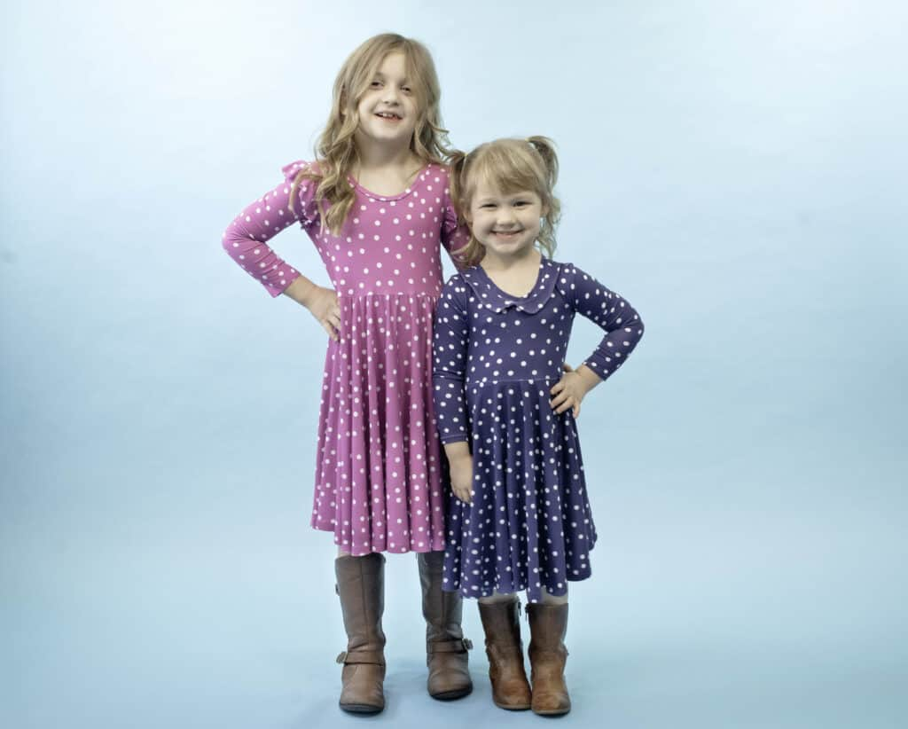 Free Girls Dress Sewing Pattern |Circle Skirt Dress Pattern by popular Utah sewing blog, Sweet Red Poppy: image of two young girls wearing circle skirt dresses.