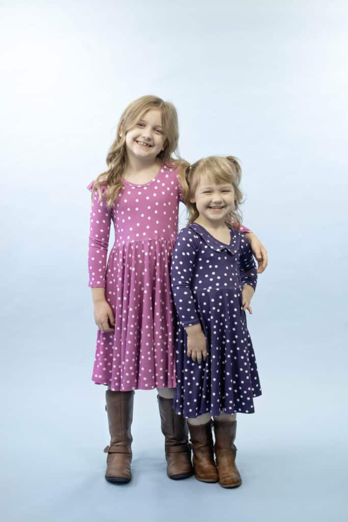 The Madeline Dress Free Sewing Pattern from Sweet Red Poppy | Circle Skirt Dress Pattern by popular Utah sewing blog, Sweet Red Poppy: image of two young girls wearing polka dot circle skirt dresses.