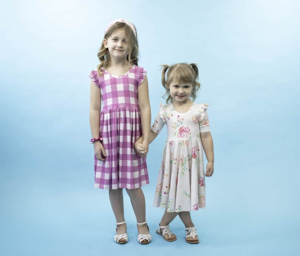 The Madeline Dress Sewing Pattern |Circle Skirt Dress Pattern by popular Utah sewing blog, Sweet Red Poppy: image of two young girls wearing circle skirt dresses.