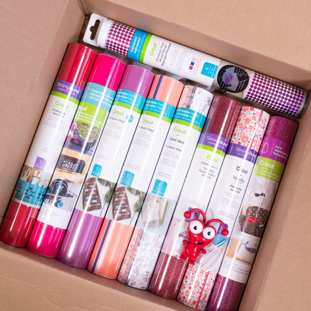 Cricut Mystery Box by popular Utah craft blog, Sweet Red Poppy: image of a cardboard box filled with Cricut iron-on vinyl and a Cricut cutie.