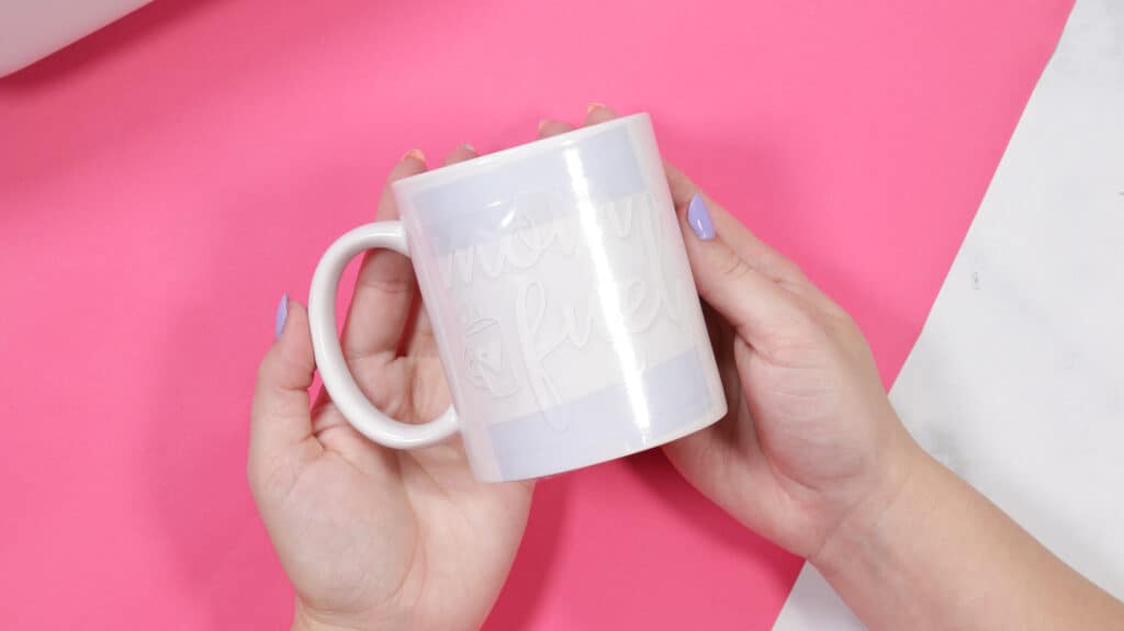 Cricut mug press review featured by top Cricut blogger, Sweet Red Poppy |Cricut Mug Press by popular US craft blog, Sweet Red Poppy: image of a white ceramic mug with heat resistant tape on it.