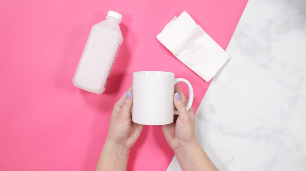 How to Create a Custom Mug with Cricut's Mug Press and Infusible Ink Transfer Sheets, a tutorial featured by top Cricut blogger, Sweet Red Poppy |Cricut Infusible Ink Transfer Sheets by popular US craft blog, Sweet Red Poppy: image of a woman holding a white ceramic mug in her hands.