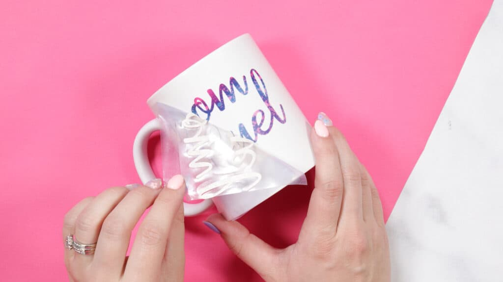 Cricut mug press review featured by top Cricut blogger, Sweet Red Poppy |Cricut Mug Press by popular US craft blog, Sweet Red Poppy: image of a woman pilling