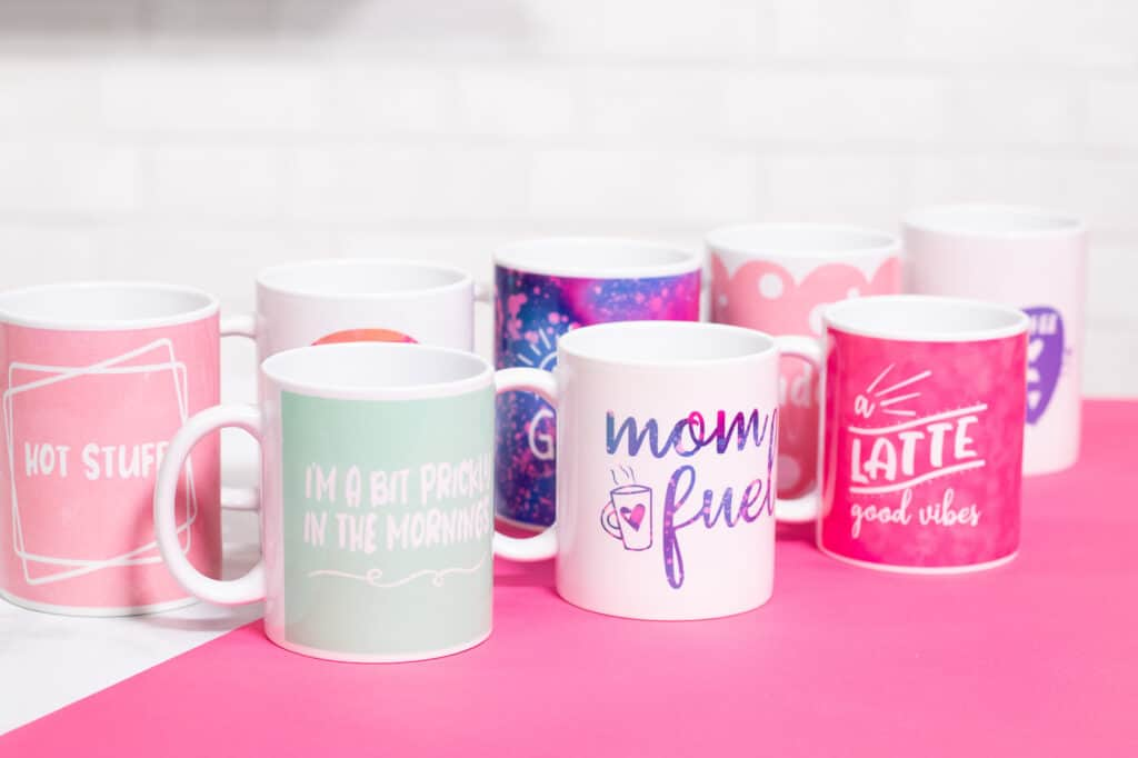 Cricut mug press review featured by top Cricut blogger, Sweet Red Poppy |Cricut Mug Press by popular US craft blog, Sweet Red Poppy: image of white ceramic mugs with Cricut mug press decals.