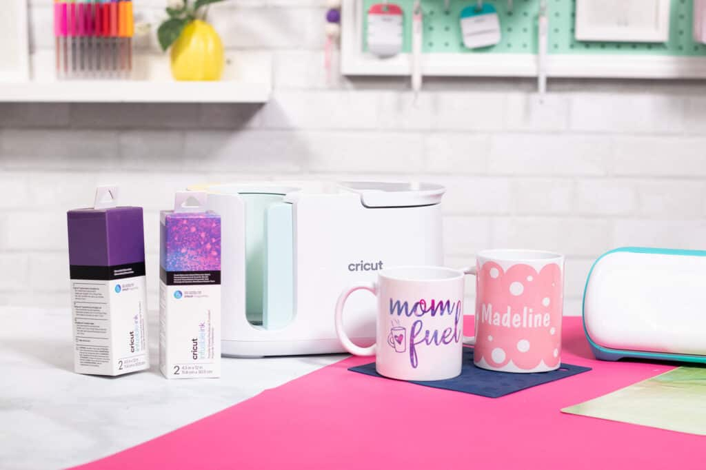 Cricut mug press review featured by top Cricut blogger, Sweet Red Poppy | Cricut Mug Press by popular US craft blog, Sweet Red Poppy: image of a Cricut mug press and ceramic mugs.