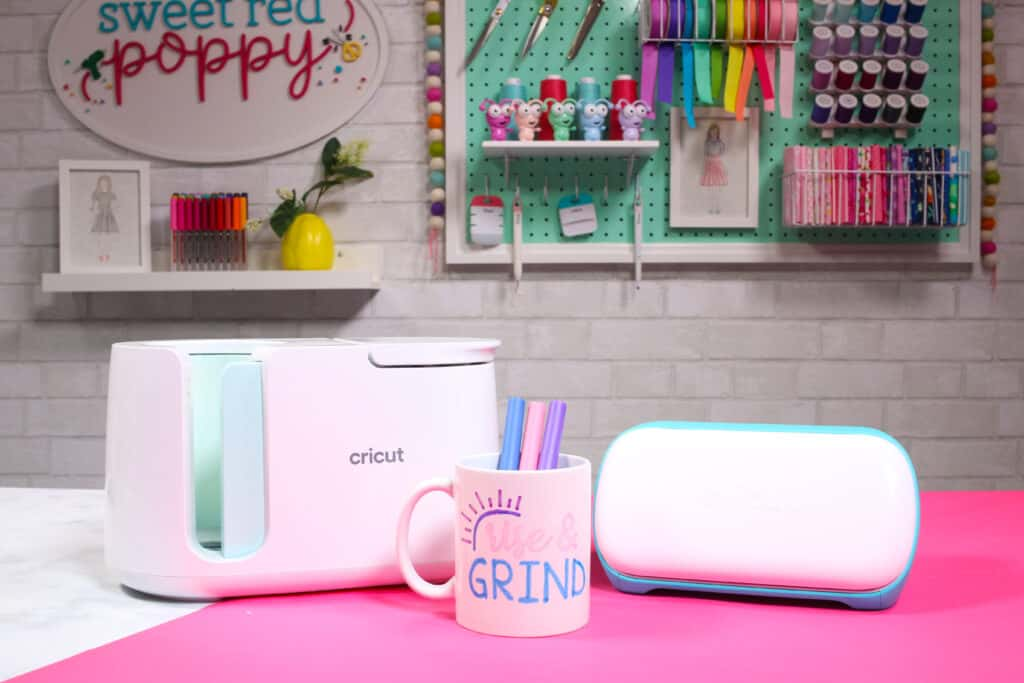 Cricut Infusible Ink Pens by popular US craft blog, Sweet Red Poppy: image of a white ceramic mug containing Cricut infusible ink pens and resting next to a Cricut mug press.