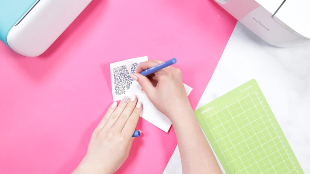 Cricut Infusible Ink Pens by popular US craft blog, Sweet Red Poppy: image of a woman using a Cricut Infusible ink pen.