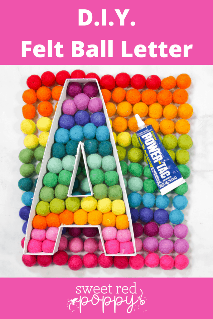 Felt Ball Letters by popular US craft blog, Sweet Red Poppy: Pinterest image of a white cardboard letter A filled with rainbow felt balls.