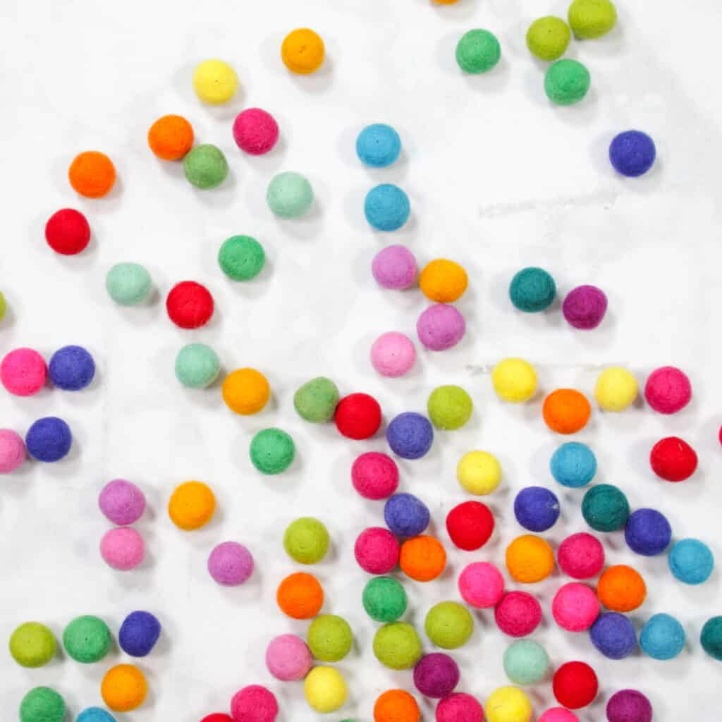 Felt Ball Letters by popular US craft blog, Sweet Red Poppy: image of rainbow felt balls.