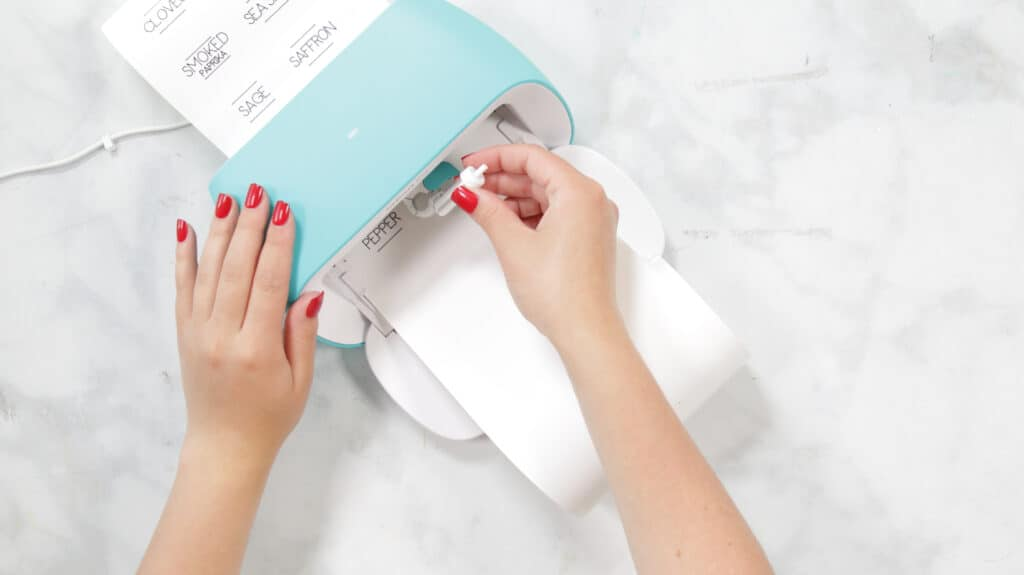 Insert Fine-Point Blade |Kitchen Organization Hacks by popular US craft blog, Sweet Red Poppy: image of a woman inserting a fine-point blade.