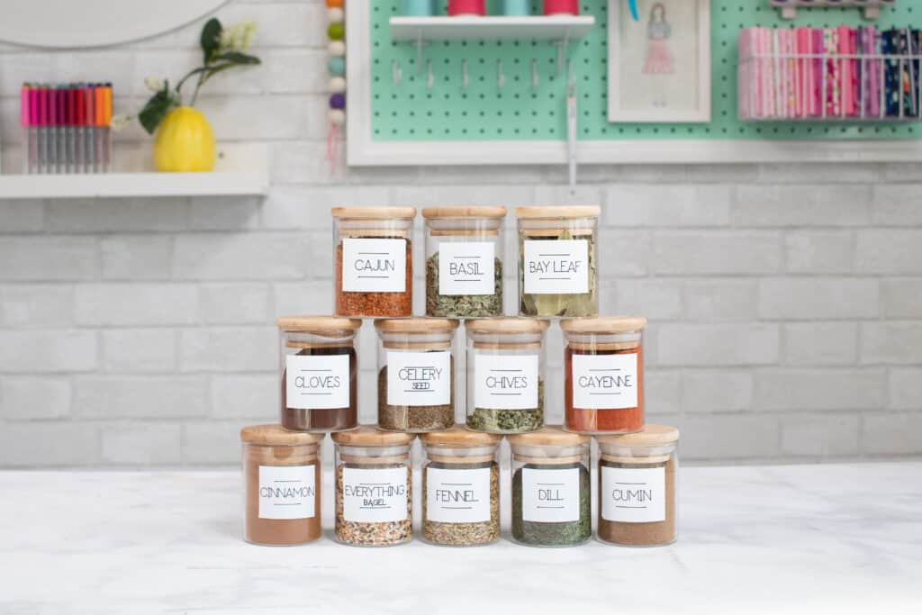 Spice Jar Labels |Kitchen Organization Hacks by popular US craft blog, Sweet Red Poppy: image of spice jars with Cricut labels on them.