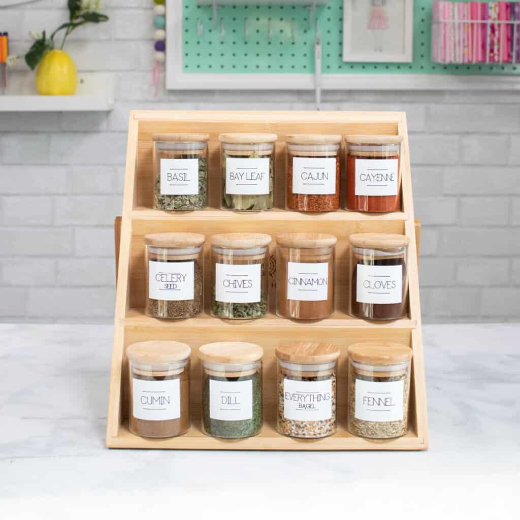 Bamboo Spice Jar Labels |Kitchen Organization Hacks by popular US craft blog, Sweet Red Poppy: image of glass spice jars with Cricut labels.