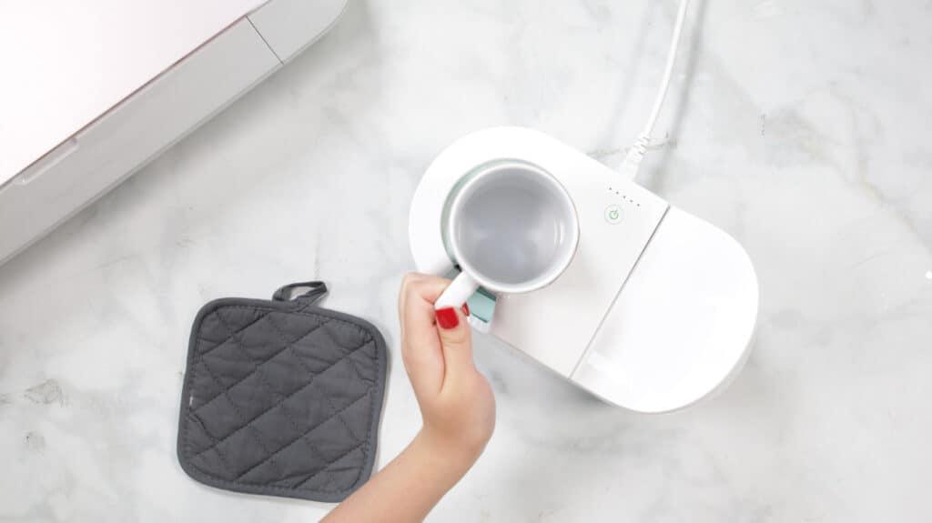 Insert Mug |Mother's Day Mug by popular US craft blog, Sweet Red Poppy: image of a woman using a Cricut mug press.