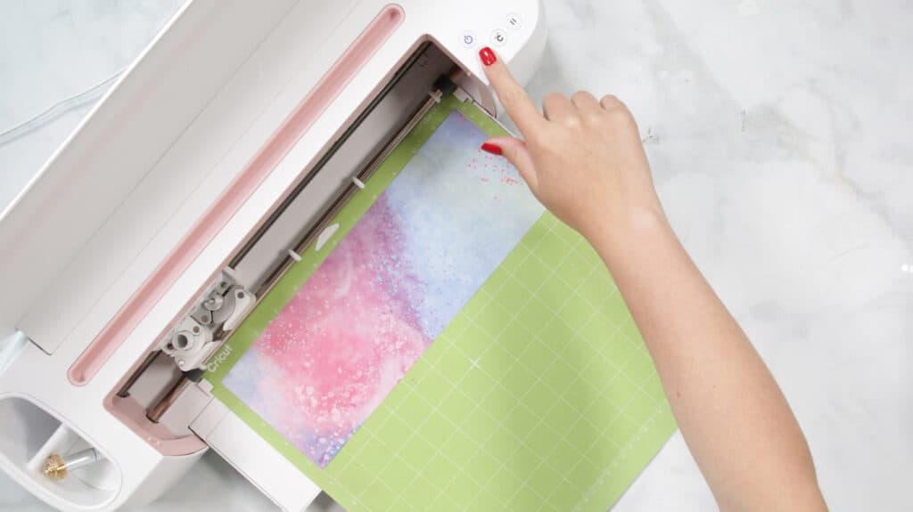 Unload Mat |Mother's Day Mug by popular US craft blog, Sweet Red Poppy: image of a Cricut infusible ink sheet on a Cricut standard grip mat in a Cricut machine.
