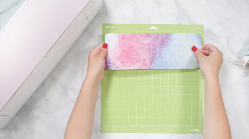 Place Infusible Ink Transfer Sheet on Mat |Mother's Day Mug by popular US craft blog, Sweet Red Poppy: image of a Cricut infusible ink sheet on a Cricut standard grip mat.