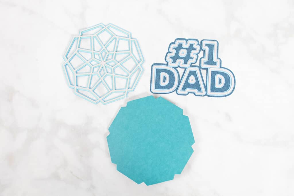 DIY Father's Day Card by popular US craft blog, Sweet Red Poppy: image of a #1 Dad cutout and mandala cutout.