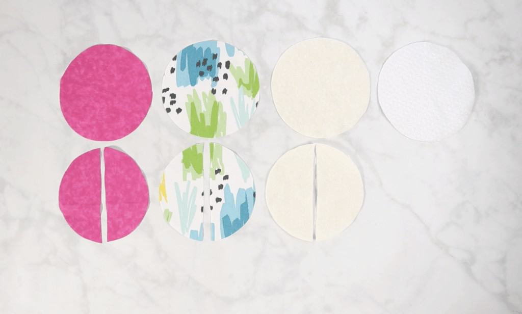 Oven Mitt Sewing Pattern by popular US sewing blog, Sweet Red Poppy: image of circular pieces of pink white, cream, and blue, white, yellow, green, and black fabric cut in half.