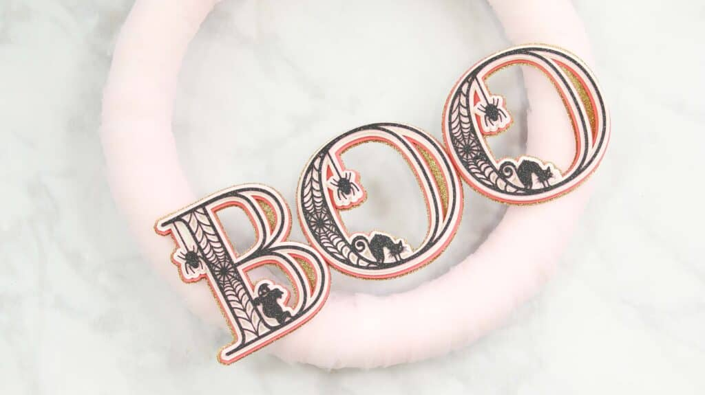 Paper Wreath by popular US craft blog, Sweet Red Poppy: image of a white tulle wreath with 3D letters that spell the word boo.
