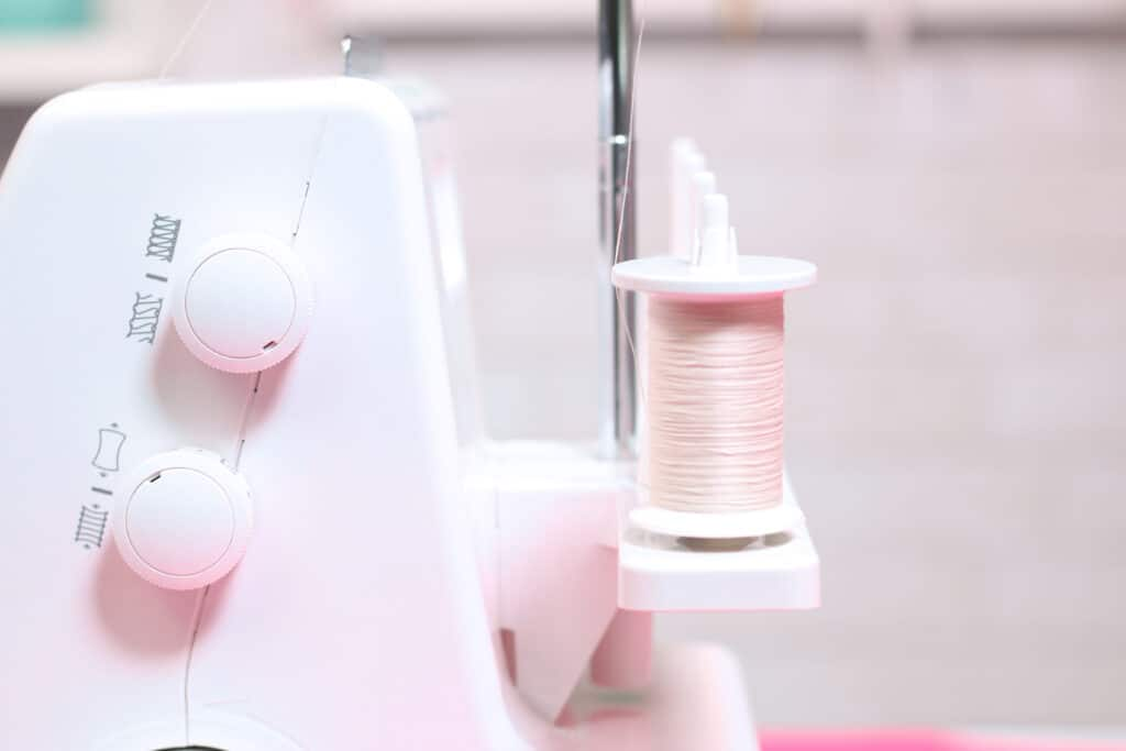 Spool Caps. |Serger Machine by popular US sewing blog, Sweet Red Poppy: image of spool caps.