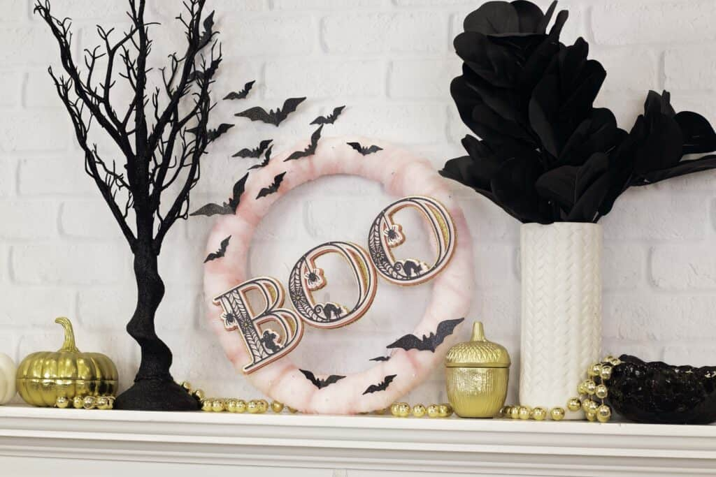 Paper Wreath by popular US craft blog, Sweet Red Poppy: image of a Halloween wreath with pink tulle, layered 3D letters, and black paper bats.