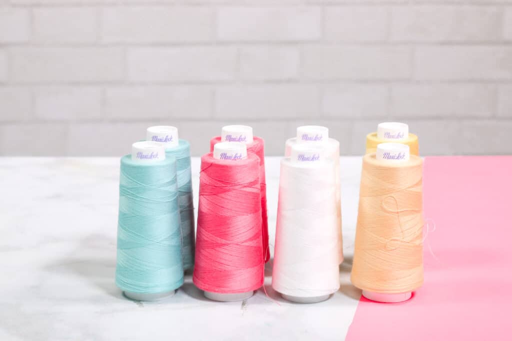 Serger Thread Cones | Serger Machine by popular US sewing blog, Sweet Red Poppy: image of serger thread cones.