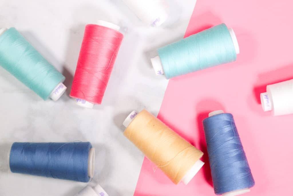 How many threads does a serger have?   Serger VS Sewing Machine by popular US sewing blog, Sweet Red Poppy: image of serger thread cones.